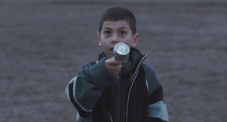Xocalı soyqırımında əlindəki fənər 6 yaşlı uşağı xilas edib - VİDEO